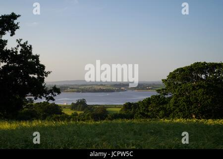 Evening View over the Exe Estuary from Powderham Folly. Devon, UK. June, 2017. - Stock Photo