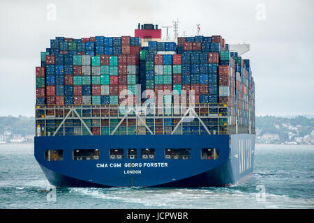 Large container ship, the CMA CGM Georg Forster, in the Solent leaving Southampton docks, England - Stock Photo
