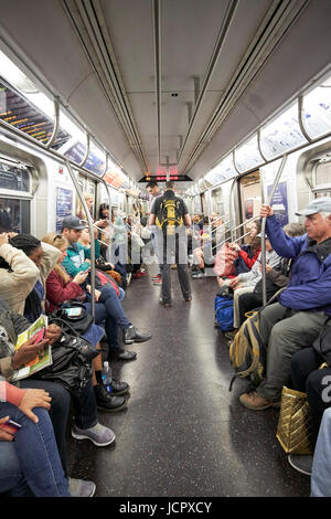 passengers on board carriage of new york subway c line train New York City USA - Stock Photo