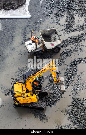 Digger and dumper truck aerial view - Stock Photo