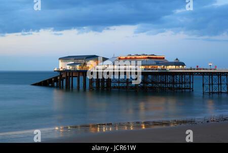 Dusk descends on Cromer's pier, North Norfolk, England, Europe - Stock Photo