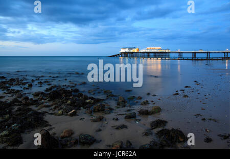 Dusk descends on the pier at Cromer, North Norfolk, England, Europe - Stock Photo