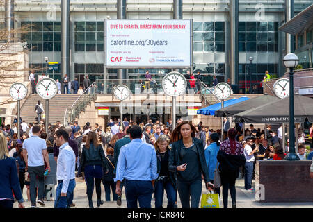 London, UK - May 10, 2017 - Reuters Plaza in Canary Wharf packed with business men and women during lunch break - Stock Photo
