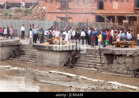 Cremation Ceremony at the Ghats site and the Holy Temple of Lord Shiva in Pasupatianth Temple, Kathmandu,Nepal,Asia - Stock Photo