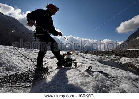 A cave explorer on the Aletsch Glacier in Switzerland. - Stock Photo