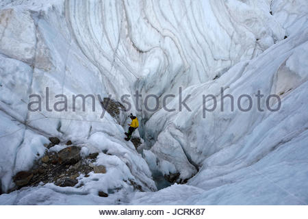 Italian cave explorer and Rolex Award 2014 winner Francesco Sauro rigs the ropes and begins his descent down into - Stock Photo