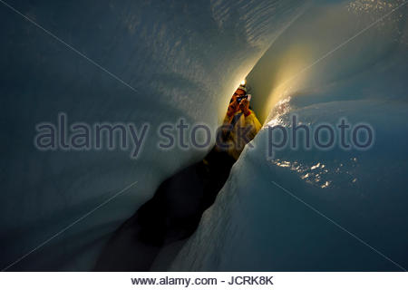 Italian cave explorer and Rolex Award 2014 winner Francesco Sauro uses a red laser measuring device to accurately - Stock Photo
