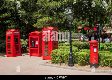 Iconic red phone boxes and mail box at Epcot theme park in Orlando, Florida. - Stock Photo