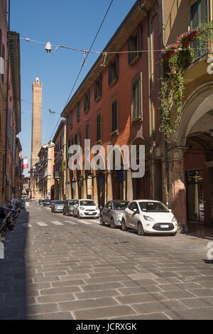 Bologna, Italy - April 22, 2017: Tower of the Asinelli view from the Strada Maggiore of Bologna in a sunny day - Stock Photo
