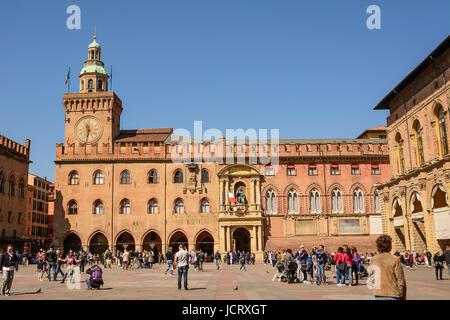 Bologna, Italy - April 22, 2017: Palace of Accursio in Piazza Maggiore of Bologna with tourists on a sunny day - Stock Photo