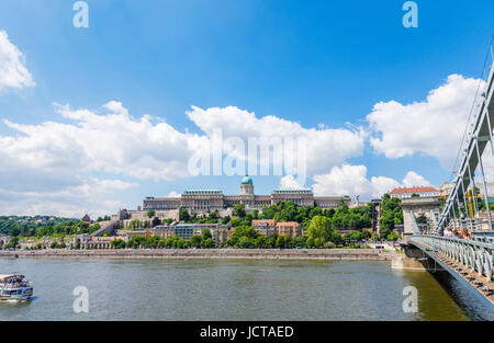 The iconic Chain Bridge (Lanchid) leading to Buda over the River Danube and Buda Castle, viewed from Pest, Budapest, - Stock Photo