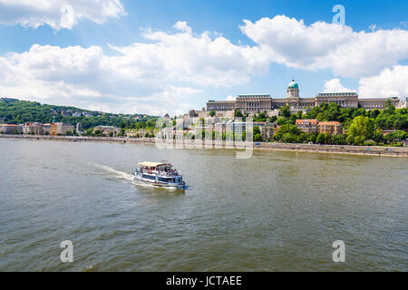 Tourist riverboat on the River Danube and the Buda Castle Royal Palace in Buda, Budapest, capital city of Hungary, - Stock Photo