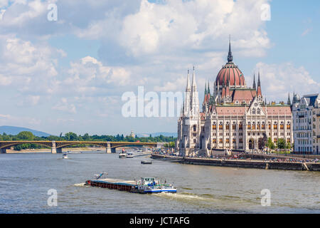 Hungarian Parliament Building in Pest on the banks of the River Danube and Margaret Bridge seen from Buda, Budapest, - Stock Photo