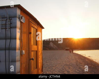 A traditional Russian Sauna (Banya) on the edge of Lake Baikal. It is customary to sit in the sauna, and then walk - Stock Photo