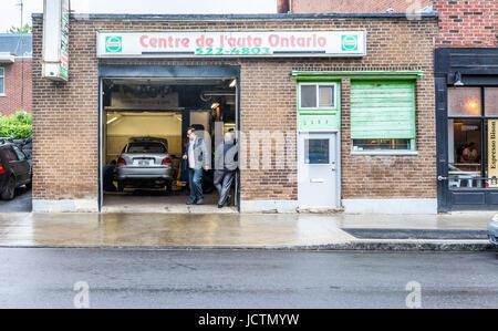 Montreal, Canada - May 26, 2017: Auto service shop called 'centre de l'auto Ontario' with Castrol sign - Stock Photo