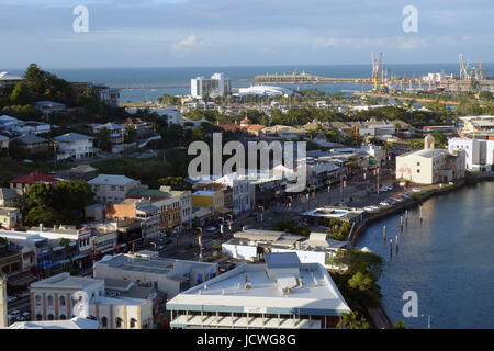 View over Flinders St, Townsville, with Ross River and port facilities, and Cleveland Bay in background, Queensland, - Stock Photo