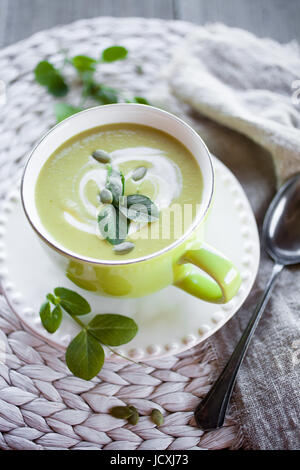 Fresh and healthy green pea soup - Stock Photo