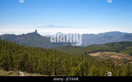 Gran Canaria, view from Pico de Las Nieves towards Teide on Tenerife, Roque Nublo to the left, Roque Bentayga center - Stock Photo
