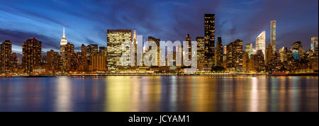 Midtown East skyscrapers from the East River at twilight. New York City - Stock Photo