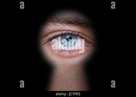 man peeping through keyhole privacy concept - Stock Photo