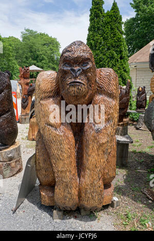 Chainsaw wood carving by Artist Fred Steffen for sale roadside near the LIE in Manorville, New York. - Stock Photo
