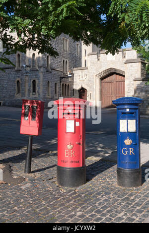 Red and blue postboxes and stamp machine, Windsor, Berkshire, England, United Kingdom - Stock Photo
