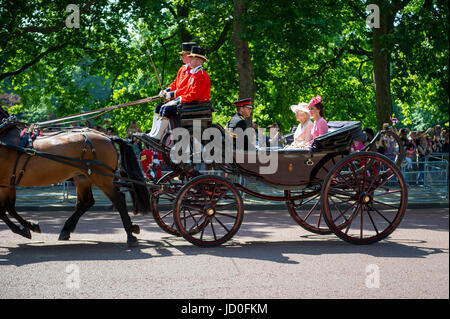 LONDON, UK - JUNE 17, 2017: Duchess of Cambridge, Duchess of Cornwall and Prince Harry travel by horse drawn carriage - Stock Photo