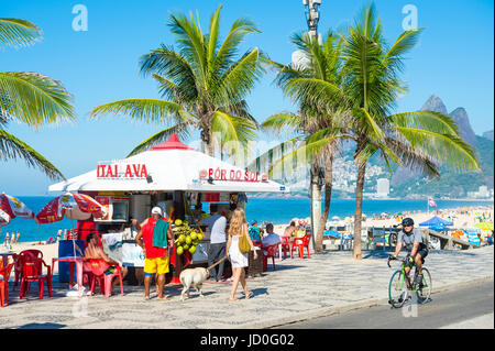 RIO DE JANEIRO - FEBRUARY 19, 2017: Customers wait for service at a kiosk selling drinks and coconuts at the Arpoador - Stock Photo