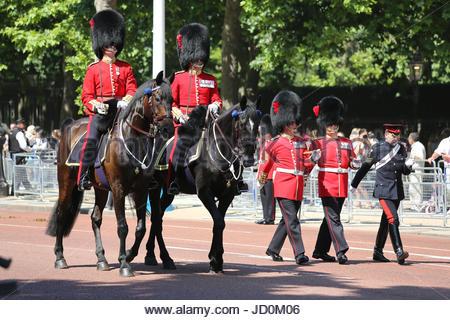 London, UK. 17th June, 2017. Officers of the Coldstream Guards riding on horseback, with senior NCOs alongside walking - Stock Photo