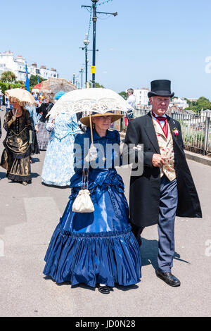 Senior couple taking a stroll on the seafront promenade at Broadstairs. Both are dressed up in upper class Victorian - Stock Photo