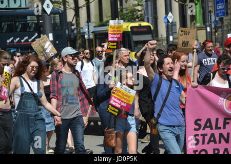 Manchester, UK. 17th June, 2017. Protestors take part in a march against the Tory-DUP government with placards and - Stock Photo