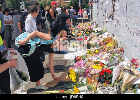 Grenfell Tower Disaster.People lay floral tributes to the Grenfell Fire Disaster - Stock Photo