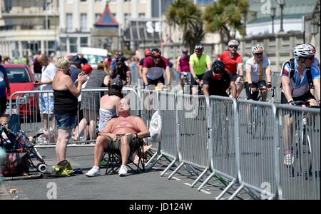 Brighton, UK. 18th June, 2017. Time to sunbathe at the annual British Heart Foundation London to Brighton Bike Ride - Stock Photo