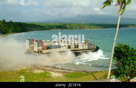 A Navy Landing Craft Air Cushion - LCAC -enters the surf from the island of Jolo, Philippines.   DoD photo by Petty - Stock Photo