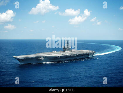 The Nimitz-class aircraft carrier USS Dwight D. Eisenhower (CVN 69) conducts a turn in the Atlantic Ocean. U.S. - Stock Photo