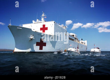 The hospital ship USNS Mercy (T AH 19) moors off the coast of the island of Kupang in West Timor, Indonesia, as - Stock Photo