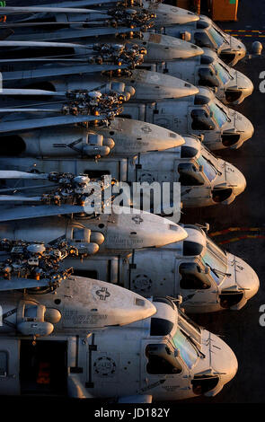 SH-60 Seahawk helicopters sit on the flight deck aboard the Nimitz-class aircraft carrier USS Harry S. Truman (CVN - Stock Photo