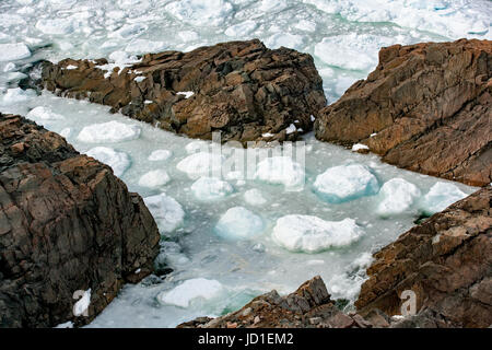 Rocky Shoreline and sea ice - Cape Bonavista, Bonavista, Newfoundland, Canada - Stock Photo