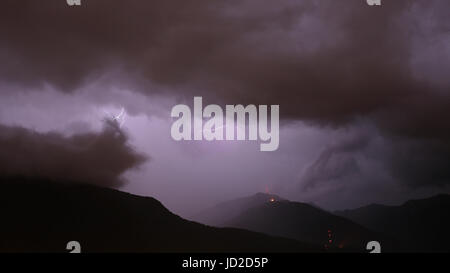 Heavy thunderstorm and lightning strikes over Monte Ceneri pass and Monte Tamaro, Ticino, Switzerland Stock Photo