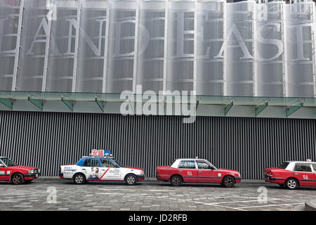 Row of Red and white Hong Kong taxi, 1 Island East - Stock Photo
