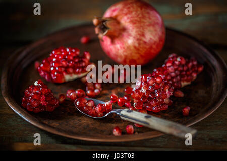 Ripe pomegranate fruit on  vintage background - Stock Photo