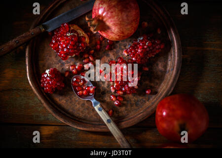 Broken and whole red ripe juicy pomegranates - Stock Photo