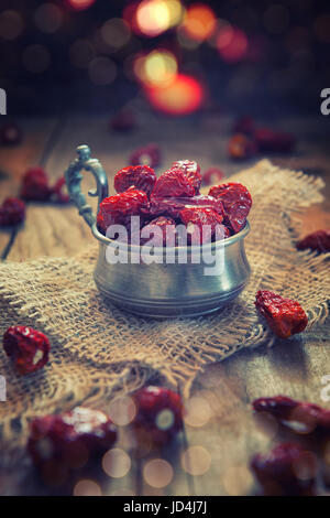 Red chili pepper in a cup on wood aces table - Stock Photo