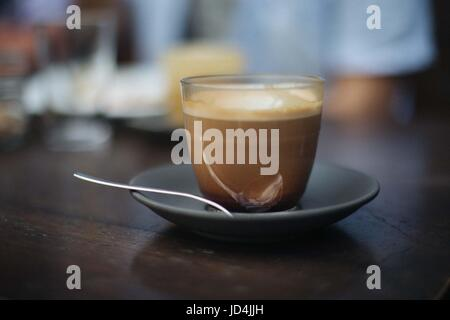 Cool photo of a cup of coffee in clear glass, made to look vintage. - Stock Photo