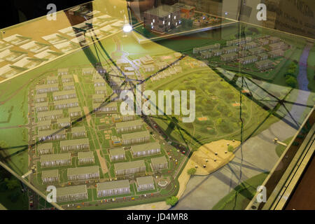 Miniature model, miniature toy buildings, cars and people. City maquette - Stock Photo