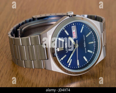 Men's Lorus analogue wristwatch, with deep blue face, day and date display and stainless steel case and multilink - Stock Photo