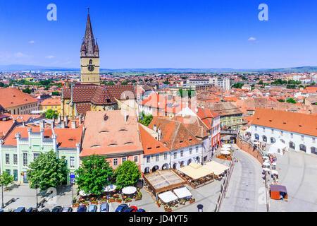 Sibiu, Romania, Lutheran cathedral tower and Small Square (Piata Mica). - Stock Photo