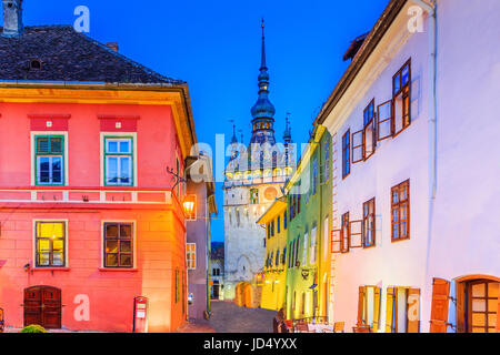 Sighisoara, Romania. Medieval street with Clock Tower in Transylvania. - Stock Photo