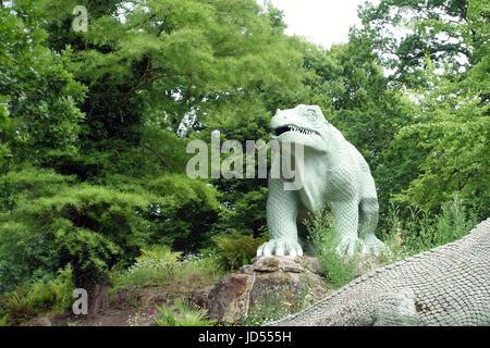 Dinosaur figures in Crystal Palace Park, South Londonr - Stock Photo