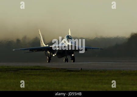 Mikoyan Gurevich Mig 29 Fulcrum Polish air force taking off at dusk at Mińsk Mazowiecki 25 miles from Warsaw Poland - Stock Photo